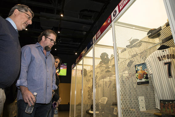 Bagwell (center) and his wife, Rachel (right), look at former teammate Craig Biggio's jersey in the Astros locker at the Today's Game exhibit during his Orientation Tour. (Milo Stewart Jr. / National Baseball Hall of Fame and Museum)