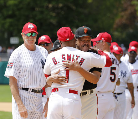 Juan Marichal gives fellow Hall of Famer Ozzie Smith a hug during the 2017 Hall of Fame Classic. (Milo Stewart Jr./National Baseball Hall of Fame and Museum)