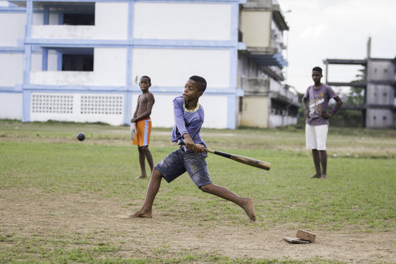 Kids play baseball in a field in Pinar del Rio on January 10, 2015 in Pinar De Rio, Cuba. (Jean Fruth / National Baseball Hall of Fame)