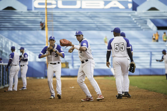 Players for the Industriales team warm up on the field prior to the game against the Ciego de Avila at Estadio Latinoamericano on January 17, 2015 in Havana, Cuba. The stadium was the singular home of Cuban Winter League games in the 1950s. (Jean Fruth / National Baseball Hall of Fame)