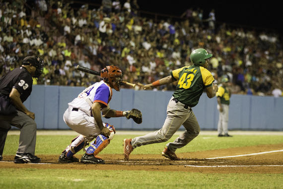 A player for Pinar del Rio bats during a game against Granma at Martires de Barbados stadium on January 16, 2015 in Bayamo, Cuba. (Jean Fruth / National Baseball Hall of Fame)