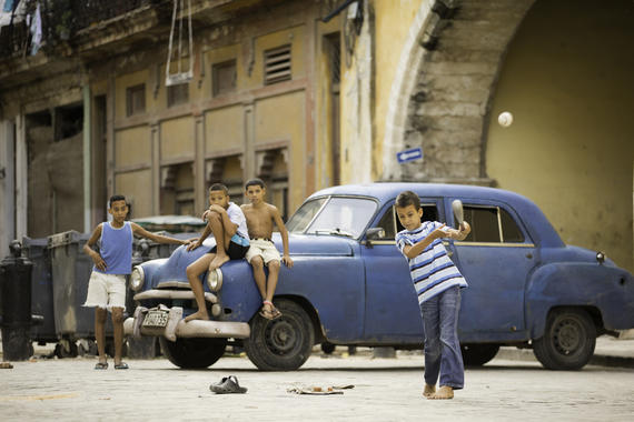Young kids play a game of baseball on the streets of Old Havana on January 11, 2015 in Havana, Cuba. (Jean Fruth / National Baseball Hall of Fame)