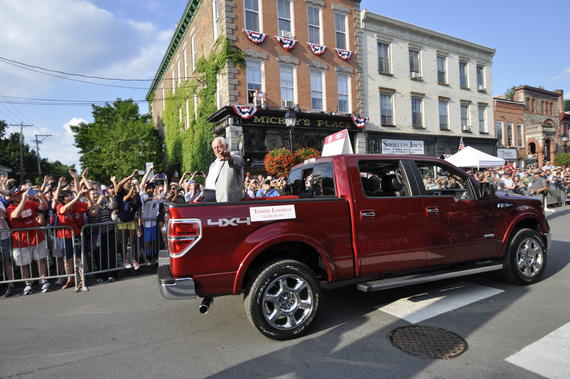 Hall of Fame manager Tommy Lasorda waves to the crowd during the annual <em>Parade of Legends</em> on Main St. in Cooperstown. (Milo Stewart, Jr. / National Baseball Hall of Fame)