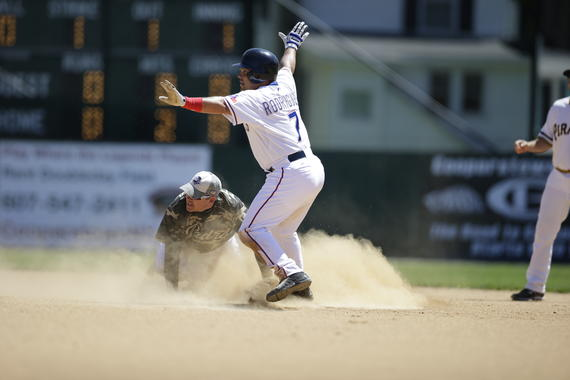 Iván Rodríguez steals second base while Mark Loretta checks out the umpire's call at the 2015 Hall of Fame Classic at Doubleday Field. (Jean Fruth/National Baseball Hall of Fame and Museum)