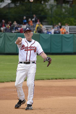 Hall of Famer Phil Niekro warms up before the 2014 Hall of Fame Classic legends game. (Milo Stewart Jr./National Baseball Hall of Fame and Museum)