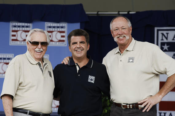 Brian Kenny (center) poses with two members of the Hall of Fame's Class of 2008: Manager Dick Williams (left) and Goose Gossage (right). Kenny hosted the Legends of the Game Roundtable at the 2008 Hall of Fame Weekend. (Milo Stewart Jr. / National Baseball Hall of Fame and Museum)
