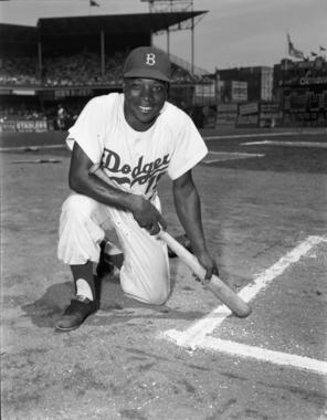 Sandy Amoros, Cuban left fielder for the Brooklyn Dodgers, posed kneeling near the batter's box. (Osvaldo Salas Collection / National Baseball Hall of Fame Library)