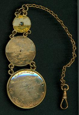 Gold fob chain pendant, with 3 club medallions issued to Mordecai Brown: 1908 World Championship, Chicago Champions of 1906, and 1907 World Championship. - B-506-52  (Milo Stewart Jr./National Baseball Hall of Fame Library)