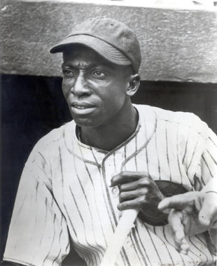 Cool Papa Bell photographed outside the dugout in an American Giants uniform. BL-3264.92 (National Baseball Hall of Fame Library)