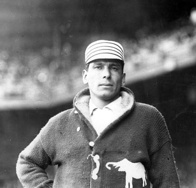 Hall of Fame pitcher Chief Bender wearing a Philadelphia Athletics uniform circa 1912.  Note the white elephant on his sweater. BL-1427.95