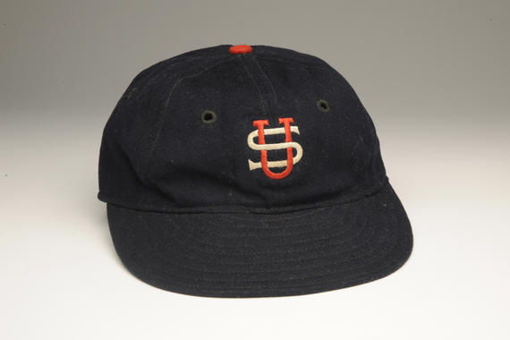 This baseball cap was worn during the 1934 tour of Japan by the American club's back-up catcher, Moe Berg. The Princeton-educated Berg, who played in just a third of the games that took place during the tour, was enthralled by his experience in the Orient. - B-139-78 (Milo Stewart, Jr./National Baseball Hall of Fame Library)
