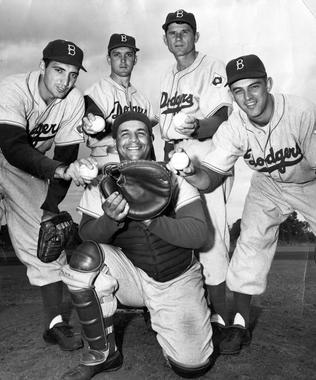 Catcher Roy Campanella and his pitchers at training camp.  Left to Right: Ralph Branca, Carl Erskine, Preacher Roe and Clem Labine, 1952. BL-4167.68HTh (National Baseball Hall of Fame Library)