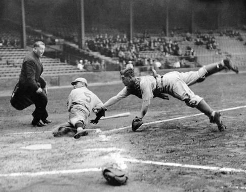 Athletics catcher Mickey Cochrane dives home and tags out Phillies base runner Pinky Whitney at Shibe Park, April 1, 1933 - BL-199-58b (National Baseball Hall of Fame Library)