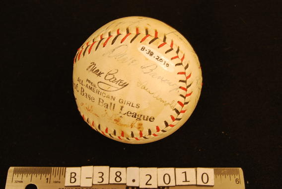 Dave Bancroft joined some of the women he managed in the All-American Girls Professional Baseball League in signing this league ball - B-38-2010  (Milo Stewart Jr./National Baseball Hall of Fame Library)