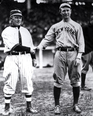 Bill Dahlen, left, shaking hands with New York Yankees third baseman (and HOFer) Frank Chance. BL-6572.92 (National Baseball Hall of Fame Library)