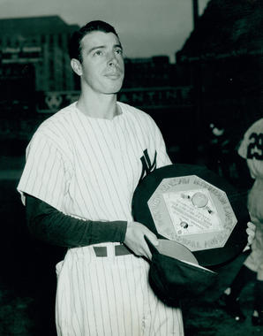 Joe DiMaggio, New York Yankees, accepting the 1947 MVP trophy - BL-7570-90 (National Baseball Hall of Fame Library)