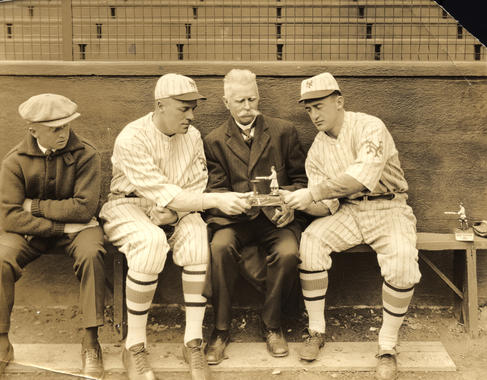 Dinty Gearin, Bill Rosy Ryan, Jim Mutrie, and Frankie Frisch, New York Giants, with Home Run King game - BL-3585-73 (National Baseball Hall of Fame Library)