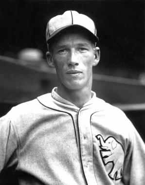 Athletics pitcher, and future Hall of Famer, Lefty Grove posing for a picture circa 1925. The white elephant is proudly featured on the left breast. BL-2552.90