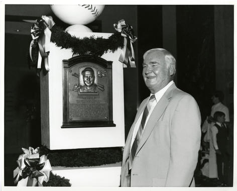 Hall of Famer Johnny Mize poses with his plaque during Hall of Fame Weekend 1981. (National Baseball Hall of Fame Library)
