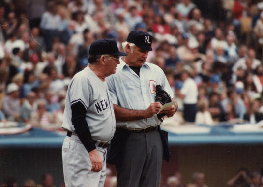Umpire Doug Harvey with New York Yankees manager Bob Lemon in Game Four of the World Series, October 25, 1981 - BL-3483-2005-55 (National Baseball Hall of Fame Library)