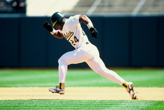 Rickey Henderson launches a steal attempt toward second base, a move that would become customary during his 25-year career in the major leagues. BL-34-2009-9 (Michael Zagaris / National Baseball Hall of Fame Library)