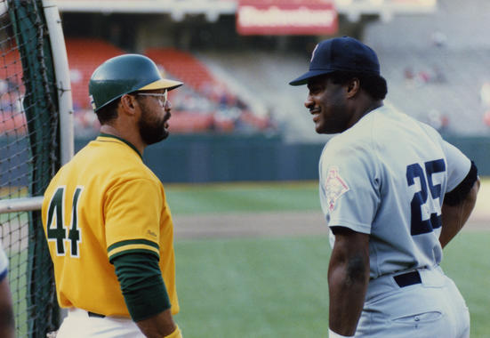 Oakland's Reggie Jackson (left) and Boston's Don Baylor, in Oakland, 1987  - BL-McWilliams 099  (Doug McWilliams/National Baseball Hall of Fame Library)