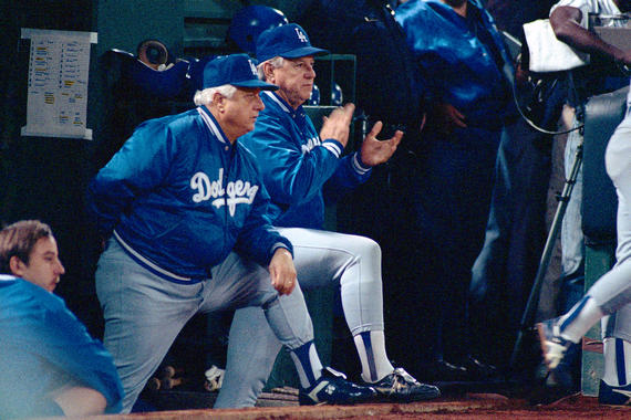 Tommy Lasorda in the Dodgers dugout. - (Brad Mangin/National Baseball Hall of Fame Library)
