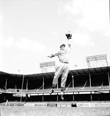 Marion stretches to catch the ball during a 1945 photo shoot. BL-251.54.28 (Look Magazine Collection / National Baseball Hall of Fame Library)