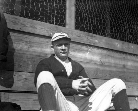 Cincinnati's Rube Marquard sitting against fence - BL-1870-97 (National Baseball Hall of Fame Library)