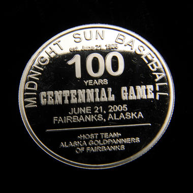 Reverse side of the commemorative medal minted in honor of the 100th Midnight Sun Game, held on June 21, 2005, in Fairbanks, Alaska. B-182.2005 (Milo Stewart Jr. / National Baseball Hall of Fame and Museum)