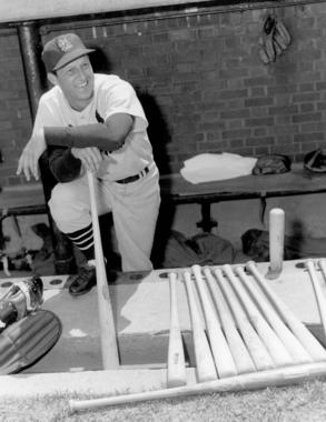 Stan Musial in dugout holding bat - BL-2025-98 (Don Wingfield/National Baseball Hall of Fame Library)
