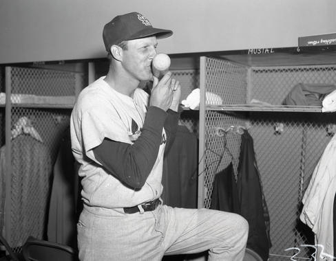 Stan Musial kisses the bat he used to collect his 3,000th career base hit, as a pinch-hitter against the Cubs on May 13, 1958. BL-77-58a (National Baseball Hall of Fame Library)
