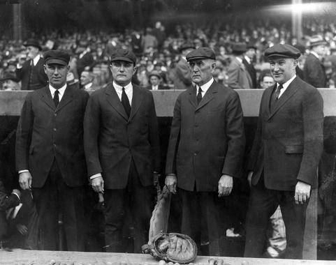 The four umpires for the first game of the 1923 World Series, October 10, 1923.  L-R  Bob Hart, Billy Evans, Hank O'Day, Dick Nallin - BL-57-74 (National Baseball Hall of Fame Library)