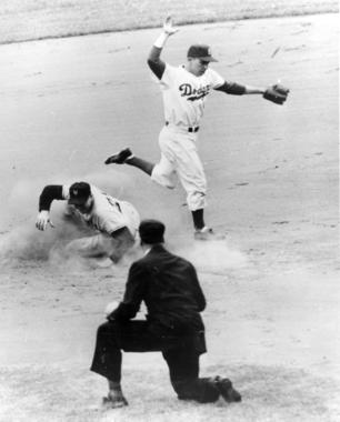 Pee Wee Reese of the Brooklyn Dodgers completing a play at second base. - BL-5812-98 (National Baseball Hall of Fame Library)