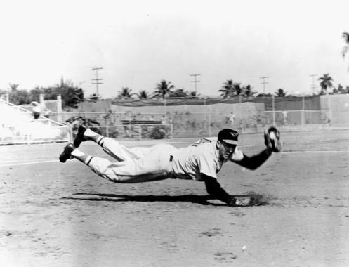 Brooks Robinson of the Baltimore Orioles makes a diving stop - BL-1022-64 (National Baseball Hall of Fame Library)