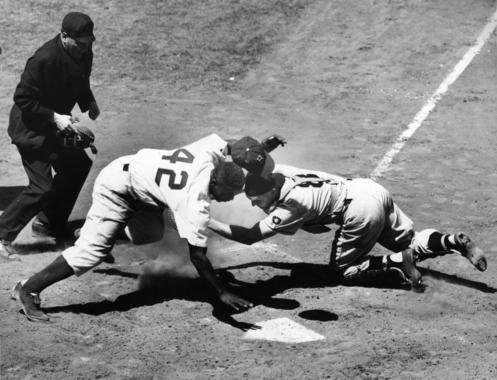 Jackie Robinson tagged out at plate by the Pirates' Clyde McCullough at Ebbets Field on May 2, 1951. Robinson Jackie 5613-73_ACT_NBL Sisto (Ernie Sisto/National Baseball Hall of Fame Library)