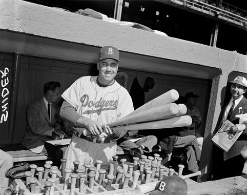 Duke Snider of the Brooklyn Dodgers selecting a bat from the bat rack. (Osvaldo Salas Collection / National Baseball Hall of Fame Library)