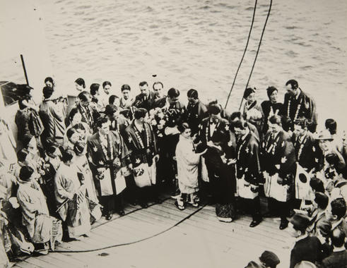 Representatives from Yomiuri, the Japanese newspaper sponsoring the tour, welcome visiting players with gifts of festival robes. – B-277-51-7 (National Baseball Hall of Fame Library)