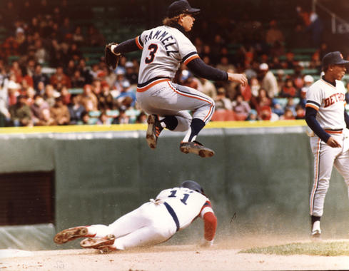 Tigers shortstop Alan Trammell leaping in the air to avoid a collision with the base runner sliding into second base. BL-2914.83 (National Baseball Hall of Fame Library)