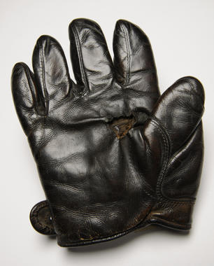 Glove used by Rube Waddell of Philadelphia Athletics when he faced Cy Young at Boston on July 4th, 1905. Both pitchers went all 20 innings with Waddell winning 4-2 - B-33-42 (Milo Stewart Jr./National Baseball Hall of Fame)