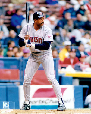 Posed full-length at bat color portrait of Hall of Famer, David Mark 'Dave' Winfield, Minnesota Twins road uniform, c. 1993-94. - B-3688-2000 (PhotoFile / National Baseball Hall of Fame Library)