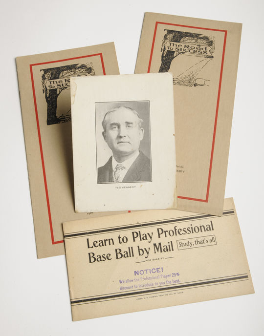 """Photo of Ted Kennedy with his brochures """"Road to Success"""" 1906, BL-2526.76 and """"Learn to Play Professional Base Ball by Mail,"""" BL-2524.76 (Milo Stewart, Jr. / National Baseball Hall of Fame and Museum)"""