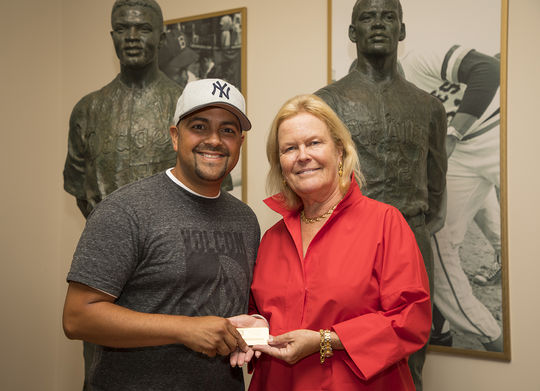 Sergio Arias from Lompoc, Calif., became the seventeen millionth visitor in Hall of Fame history on July 13, 2018. Arias, who was presented with a Lifetime Hall of Fame Membership, is pictured above with Hall of Fame Chairman of the Board, Jane Forbes Clark. (Milo Stewart Jr./National Baseball Hall of Fame and Museum)