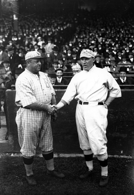Brooklyn Dodgers - then called the Brooklyn Robins - manager Wilbert Robinson shakes hands with Boston Red Sox manager Bill Carrigan before the 1916 World Series. (National Baseball Hall of Fame)