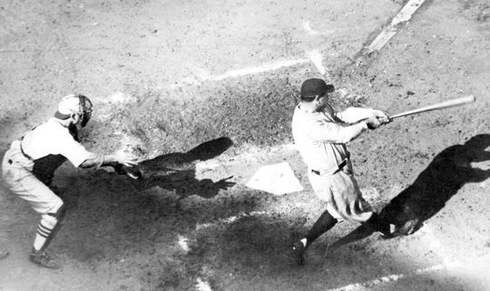 Babe Ruth hits the ball into centerfield in St. Louis on October 6th, during Game 4 of the 1926 World Series. BL-4386-87 (National Baseball Hall of Fame Library)