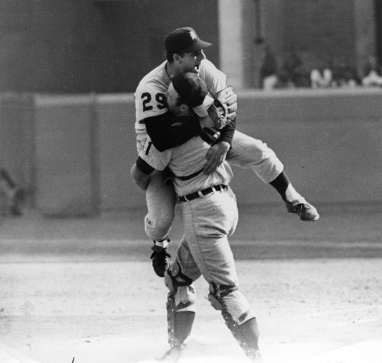 Tigers catcher Bill Freehan lifts pitcher Mickey Lolich into the air following the final out of Game 7 of the 1968 World Series. Lolich won three games during that World Series, but Denny McLain's clutch performance in Game 6 set the stage for the decisive Game 7. (National Baseball Hall of Fame and Museum)