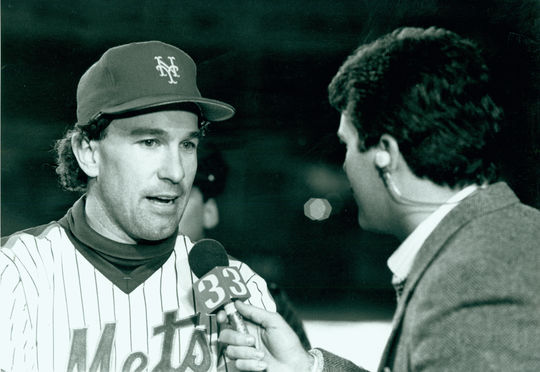 New York Mets catcher Gary Carter conducts a television interview after his two-out hit kickstarted the Mets' improbable rally in Game 6 of the 1986 World Series. BL-1693-88 (National Baseball Hall of Fame Library)