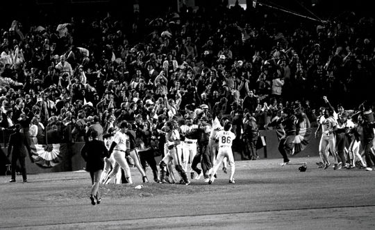 The New York Mets celebrate their improbable comeback in Game 6 of the 1986 World Series. BL-1162-88 (Tom Heitz / National Baseball Hall of Fame Library)