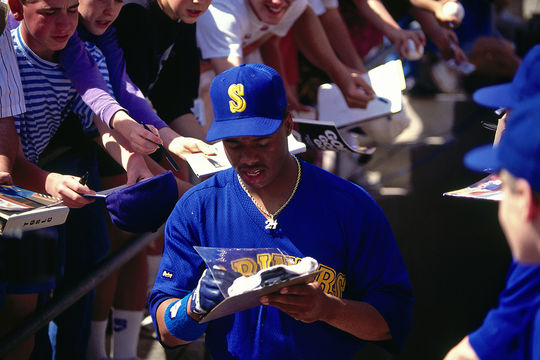 Ken Griffey Jr. signs autographs for fans in 1991, while he was playing on the Mariners. He made his major league debut at the age of 19, in 1989. (Brad Mangin/National Baseball Hall of Fame)