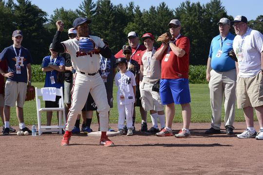 Hall of Famer Ozzie Smith shows proper throwing mechanics to participants during the annual PLAY Ball event during 2015 Hall of fame Weekend. (Milo Stewart, Jr. / National Baseball Hall of Fame)